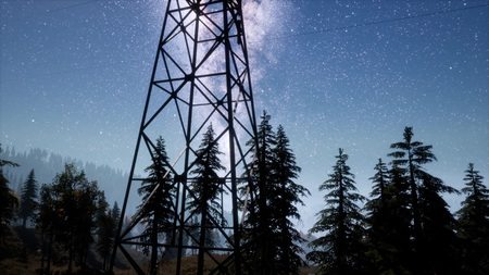 High-voltage power lines on the background of the starry sky