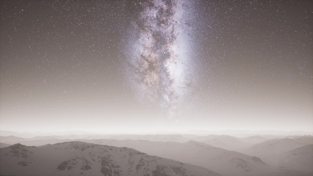 aerial view of Milky Way above snow covered terrain Standard-Bild