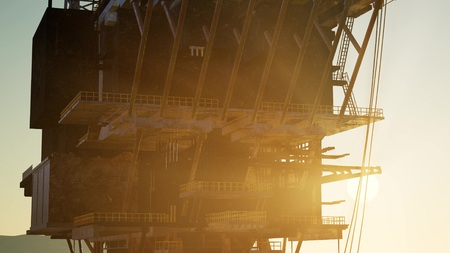 Image of oil platform while cloudless day.