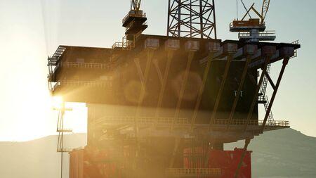 An offshore oil platform at sunset light Imagens