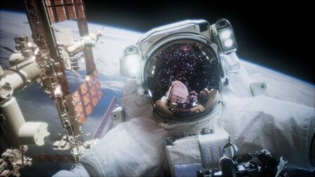 Astronaut at spacewalk. Фото со стока