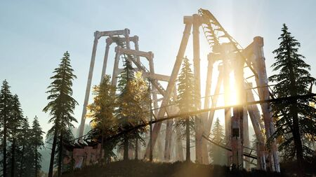 old roller coaster at sunset in forest Stock Photo