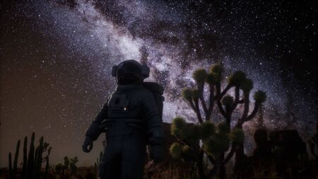 Astronaut and Star Milky Way Formation in Death Valley Фото со стока