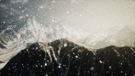 Heavy snowing, focused on the snowflakes, mountains in the background Reklamní fotografie