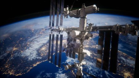 A view of the Earth and a spaceship. International space station is orbiting the Earth Archivio Fotografico