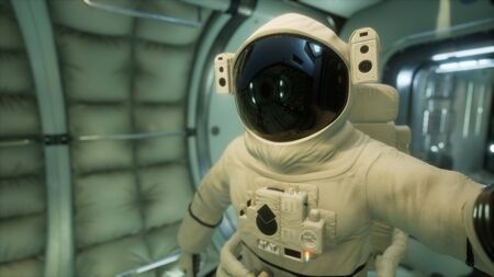 astronaut inside the orbital space station. Archivio Fotografico