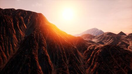 Sunlight rays over mountains in a valley