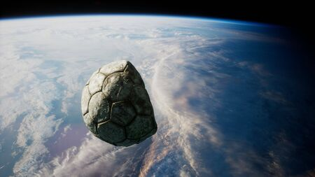old soccer ball in space on Earth orbit.