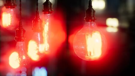 old retro vintage incandescent light bulb. loft style. ideas concept. bokeh background and copy space.