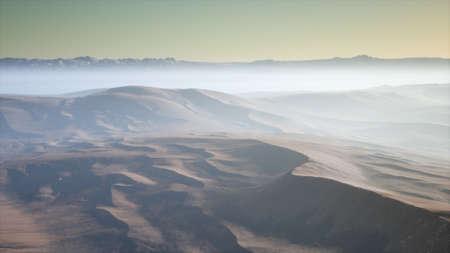 aerial of the red sand desert dunes in fog