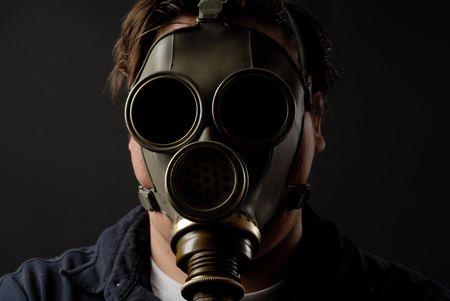 biochemical: Man in gasmask with dark background Stock Photo
