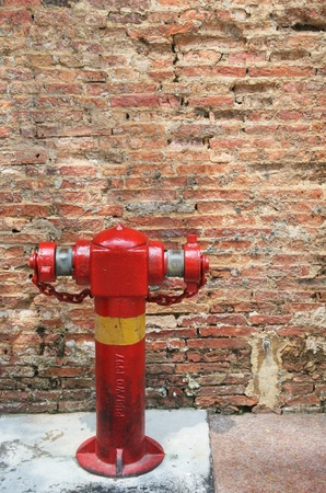 Hydrant and the simple wall