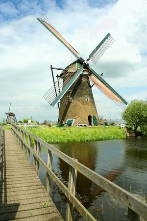 Windmill and the wooden bridge Stock Photo