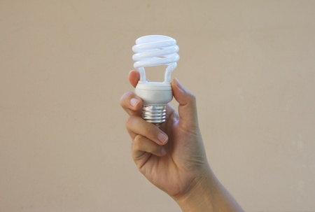 Energy saving bulb in hand photo