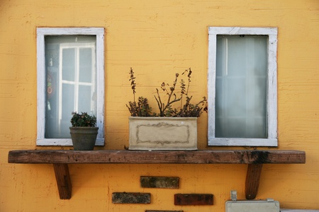 A pair of classic windows on yellow wall Stock Photo - 11713857