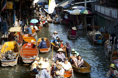 RATCHABURI, THAILAND - December 11: Many merchants row along the canal to sell their goods at floating market. This is the most traditional and famous floating market in thailand. Editorial