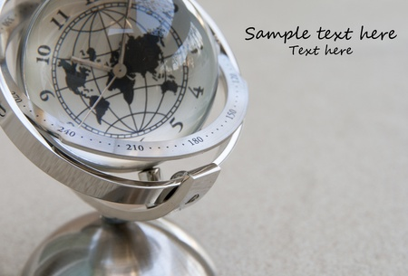 A modern globe analog clock photo