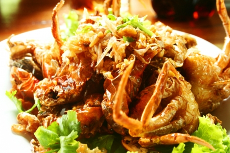 Deep fried soft shell carb with garlic photo