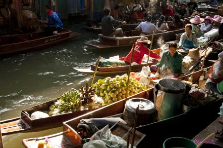 RATCHABURI,THAILAND -DEC 11  Merchants row along the canal to sell their goods at floating market on Dec 11, 2011 in Ratchaburi  This is the most traditional and famous floating market in Thailand  Stock Photo - 15460635