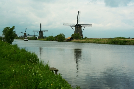 Traditional windmill in Kinderdijk, the Netherlands photo