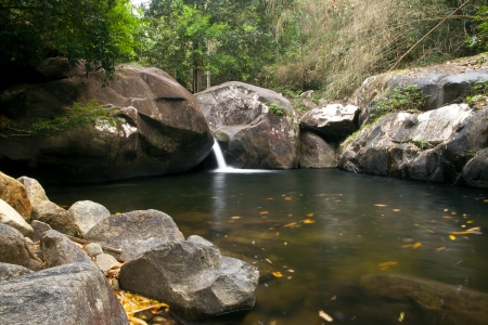 A beautiful scenery of waterfall in the Khao Chamao rainforest, Thailand photo