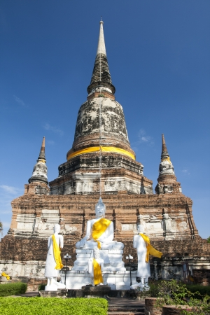 Ancient Buddha statue at Wat Yai Chaimongkol in the historical city, Ayutthaya, Thailand. Many ruined pagodas and temple show the prosperity at that ages. Stock Photo