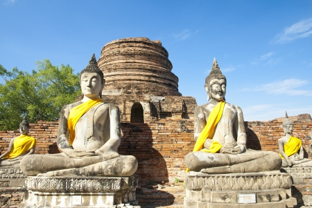 Ancient Buddha statue at Wat Yai Chaimongkol in the historical city, Ayutthaya, Thailand. Many ruined pagodas and temple show the prosperity at that ages. photo