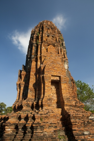 Ages pagoda at historical park, Ayutthaya, Thailand. This ruined pagoda was built around 400 years ago in the Ayutthaya kingdom period. Stock Photo - 17207892
