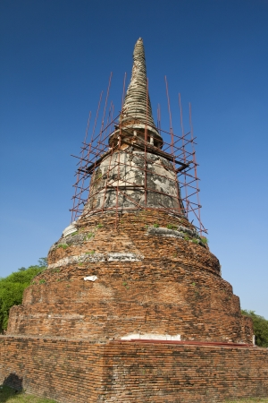 Ages pagoda at historical park, Ayutthaya, Thailand. This ruined pagoda was built around 400 years ago in the Ayutthaya kingdom period. Stock Photo - 17207919