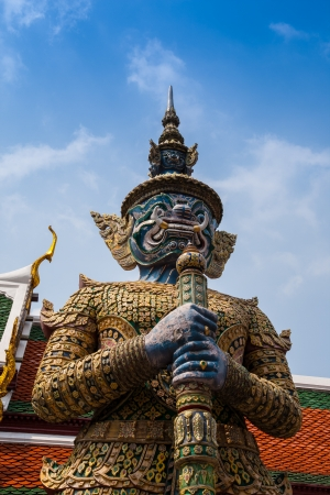 A legend giant statue with red face stand in the grand palace, Bangkok Thailand