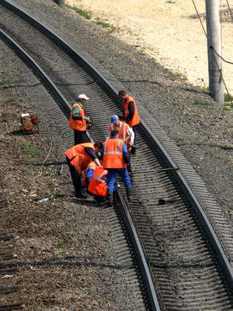Workers in orange jacket make checkup (2) Stock Photo