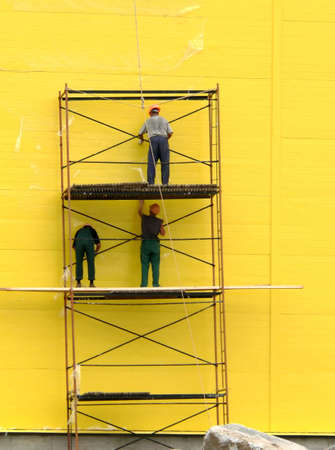 colouration: Three workers on scallolding