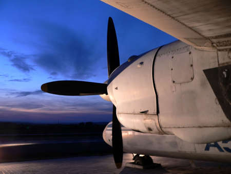 Retro plane on stop in the evening Stock Photo