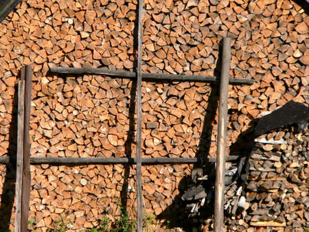 Firewood in courtyard of the rural building photo