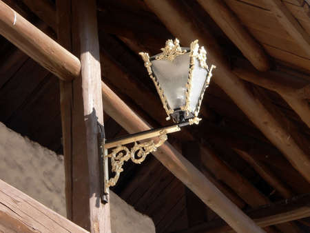 Old torch on the wall of the wooden church. photo