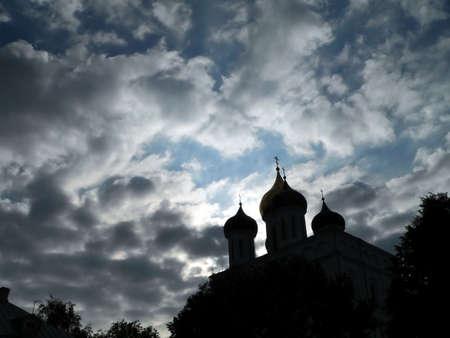 Churchs of Pskov on cloudy sky background photo