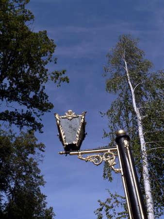 Aged gilded street lamp. Pechory. photo