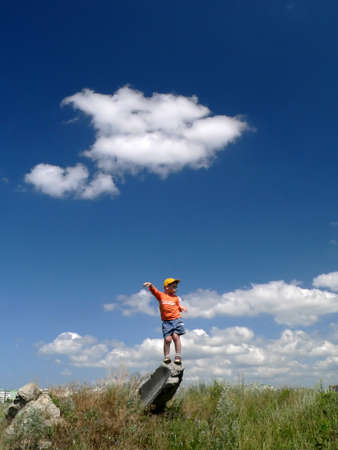 lea: Boy and cloud on the blue sky background Stock Photo