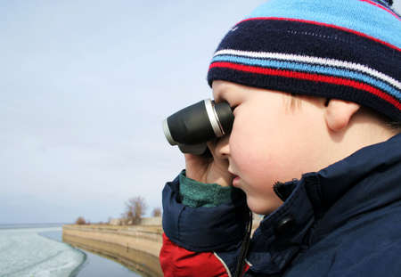 Little boy with binoculars at a sea Stock Photo - 837240
