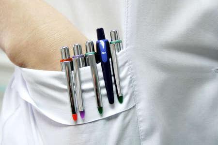 smock: Five pens in pocket of the white smock