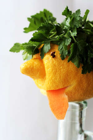 drollery: Humorous face prepared  from lemon and greens 2 Stock Photo