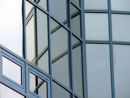 Glass windows of modern building with reflections