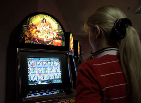 Girl in a casino, playing on a playing automat 2 photo