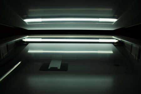 inwardly: Computers scanner inside with the lighting lamp. Stock Photo