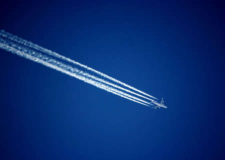 Trace of the plane on the blue sky background