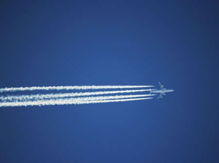 Trace of the plane on the blue sky background 2 photo