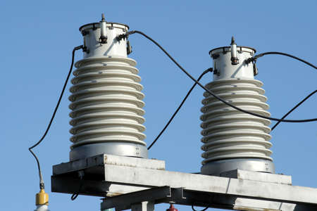 Two big insulators on the high-voltage substation Stock Photo - 939893