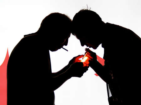 Two man with cigarette-lighter in the night photo