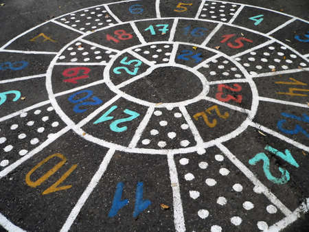 hopscotch: Numerals snail on asphalt for the playing Stock Photo