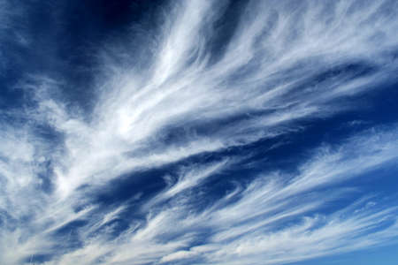 convection: Fleecy clouds on the dark-blue sky background